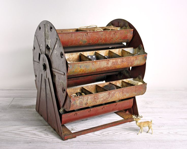 Vintage Metal Carousel Parts Bin / Metal Organizer / Industrial Storage. $78.00, via Etsy.