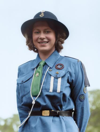 Princess Elizabeth poses in her girl guide uniform in Frogmore, Windsor, England on April 11, 1942.