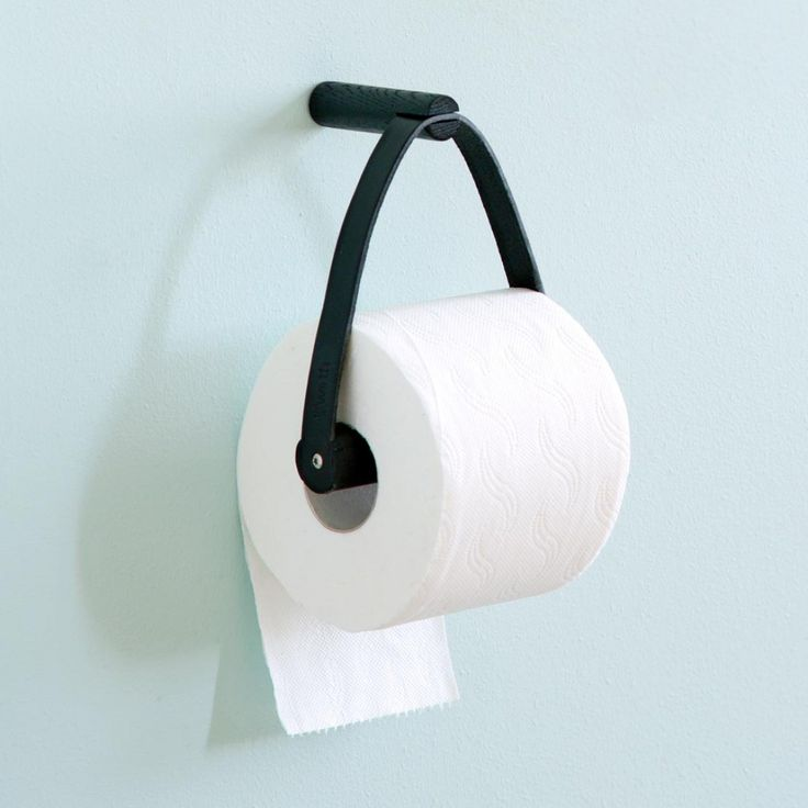 Designstuff offers the latest range of Scandinavian designed toilet paper holders in leather and black oak wood by By Wirth, Denmark.