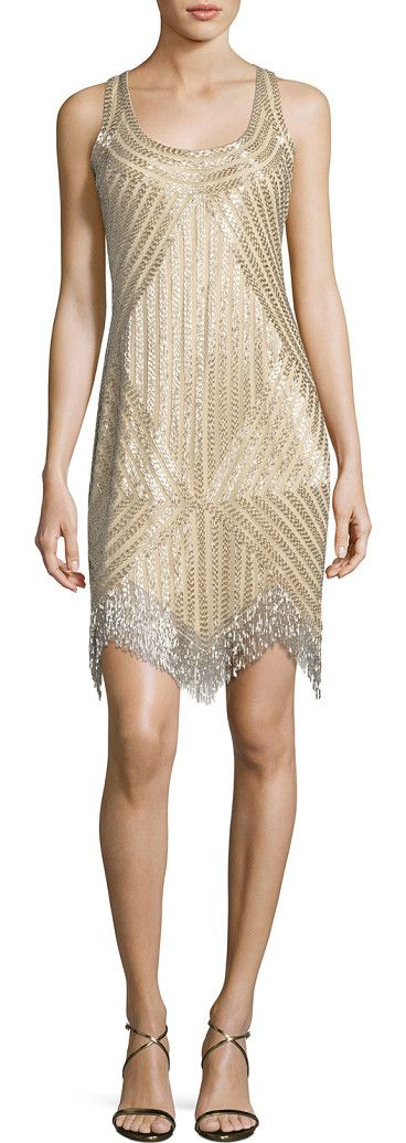 Beaded mesh dress by Aidan Mattox. Beaded light gold polyester mesh dress by Aidan Mattox. Scoop neckline. Sleeveless. Imported.