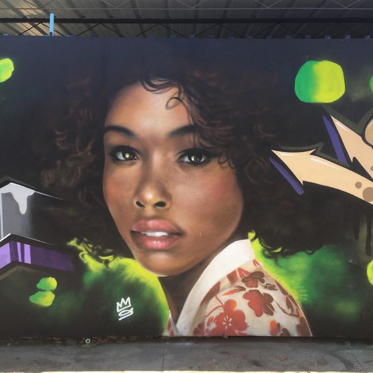 """It is not clear whether these murals are designed to represent Afro-Korean women, or if they are simply black women reimagined in traditional Korean attire. The murals, which appear in both California and Korea, often include inspirational text. One reads """"a flower has bloomed"""" another """"you will be a blessing."""""""