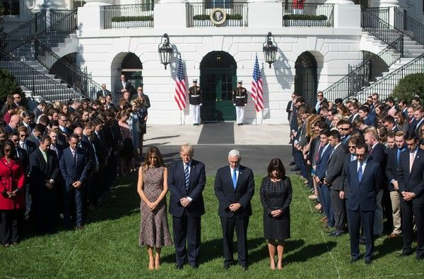 Donald Trump Photos - US President Donald Trump First Lady Melania Trump, US Vice President Mike Pence and his wife, Karen, participate in a moment of silence on the South Lawn of the White House in Washington, DC, October 2, 2017, for the victims of the shooting yesterday in Las Vegas, Nevada. / AFP PHOTO / SAUL LOEB - President Trump and First Lady Melania Trump Hold Moment of Silence for Victims of Las Vegas Shooting