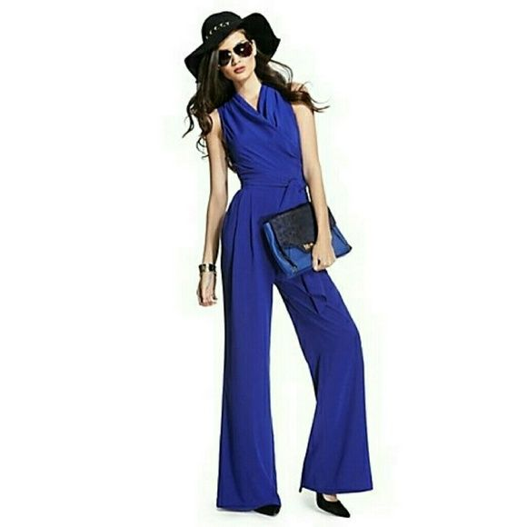 Guess by Marciano Blue Jumpsuit size 2 or XS Guess by Marciano Blue Jumpsuit. Altered to fit my height which is 5'4 . New with tags NEVER USED. Guess by Marciano Pants Jumpsuits & Rompers