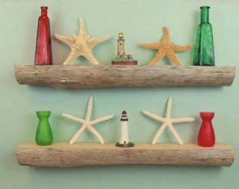 This driftwood shelf is made with naturally tumbled and weathered driftwood found on the shores of Lake Erie. It is a combination of the natural beauty of driftwood and wood grain. The shelf measures 26-1/2 long and 2 to 3-1/2 deep. The height is 1-1/2 to 7-1/2. The top surface and back of the shelf are cut and sanded smooth. Both ends are left completely uncut and natural. On the exterior, the wood is a medium to dark brown. The shelf surface is a warm brown as well with ...