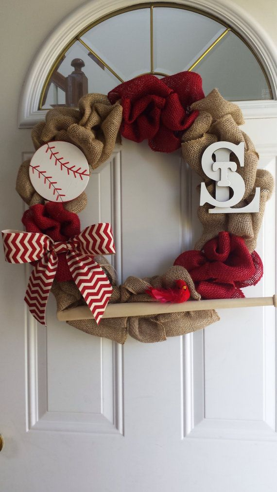Cheer on the St. Louis Cards with this awesome wreath. This 18 burlap wreath is made to order with red and natural colored burlap. It is adorned
