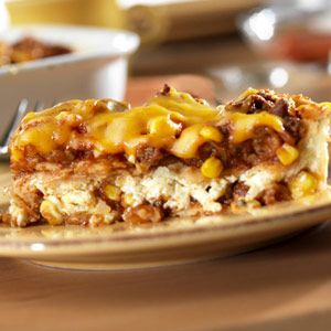 South-of-the-border flavors--picante-seasoned ground beef, corn, shredded cheese and chili powder--are layered in between corn tortillas for a saucy, pleasing casserole.