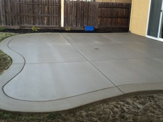 Poured Concrete Patio Designs | curved back yard patio, broom finish with border