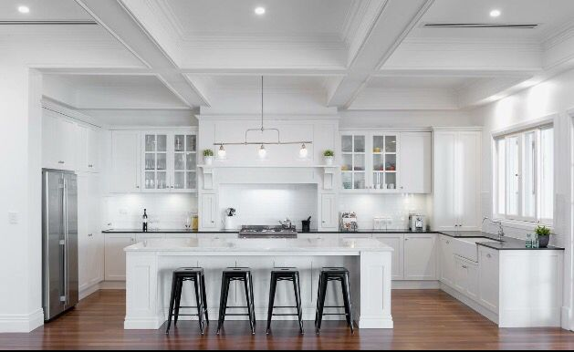 Our Hamptons inspired dream kitchen!! We used Athena smartstone for the island bench and Jet Black caesarstone for the back and side bench.
