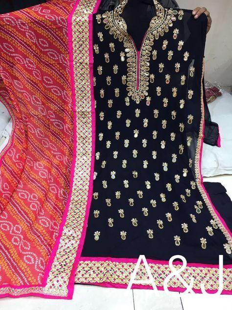 Dark blue georgette suit with bandhini dupatta. Kundan and mirror work on kurti. Comes with matching churidar.
