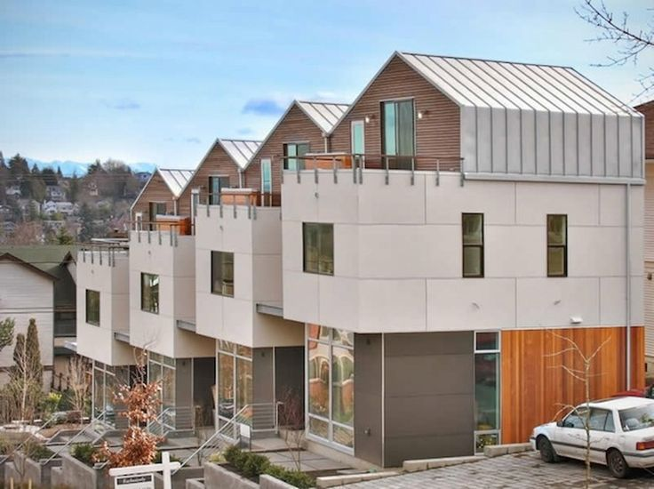 Located above Madison Valley on a hillside corner lot, this 4-unit townhouse project is designed as a dramatic addition to the neighborhood. Rooftop decks ta...