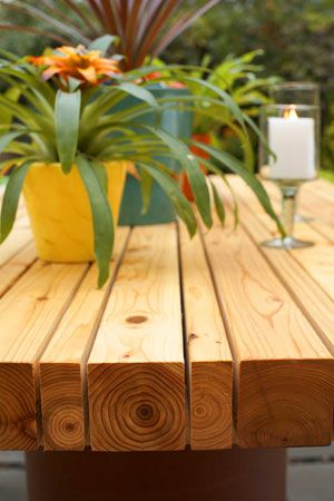 cool outdoor table-- Wonder how hard it would be to make?