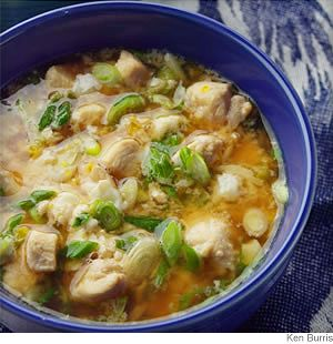 Japanese Chicken-Scallion Rice Bowl - Here's the quintessence of Japanese home cooking: an aromatic, protein-rich broth served over rice. Admittedly, Japanese cooking leans heavily on sugar - for a less traditional taste, you could reduce or even omit the sugar.
