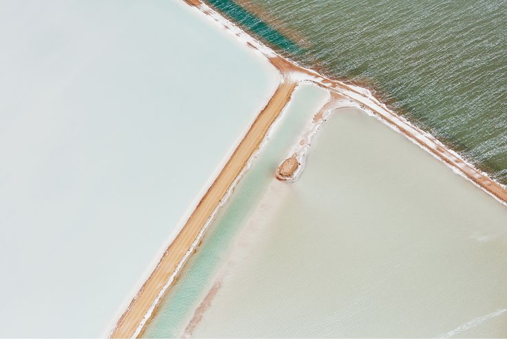 Brooke Holm - I love aerial photography, especially when it is done over salt seas like this one.  The similar colours in the frame are very beautiful colours and the lining splitting up the frame is a nice complementary.  Very minimal, but still unreal.