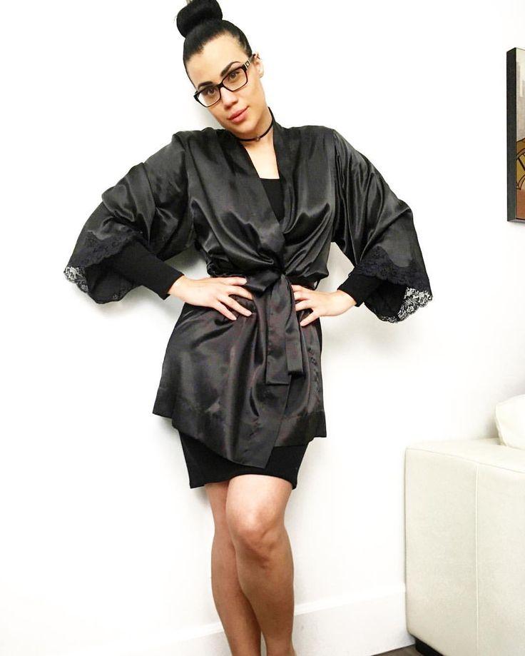 Glam up a plain black dress by adding a silk robe 😍