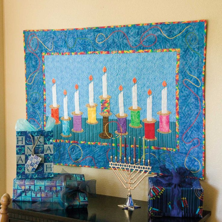 FESTIVAL OF BRIGHTS: Hanukah Menorah Wall Quilt Pattern Designed by KATHRYN PATTERSON Easy fusible applique is accented by couched yarn detailing in the border of this cheery sewing-themed menorah wall quilt. Festival of Brights will be a treasured Hanukah gift for any Jewish quilter or sewist! Pattern in The Best of McCall's Quilting - Summer 2016