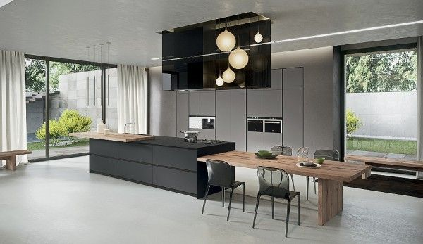 Kitchen island that offers an extended dining table in wood