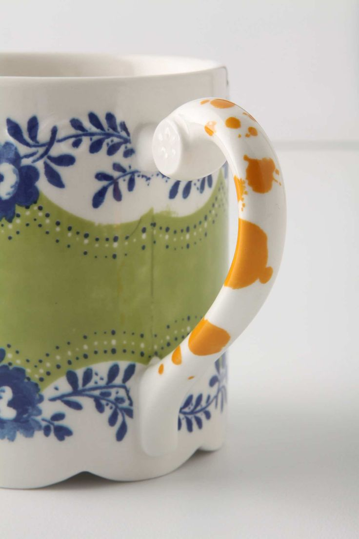 Comedy-Of-Manners Mug. Paint splatters and topsy-turvy scallops add humor to an otherwise proper mug decorated in flowers and lace.   Stoneware.  Dishwasher and microwave safe.  12 oz.  13 cm H, 8 cm diameter.    style #7544402420801 http://re.pn/b/bneK: Color, Style 7544402420801, Flower