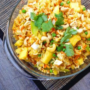 Juicy fresh pineapple mingles with hearty chicken, whole grain rice and tender-crisp veggies in a simple sauce flavored with soy sauce, sesame oil and fresh orange juice. Pineapple Fried Brown Rice