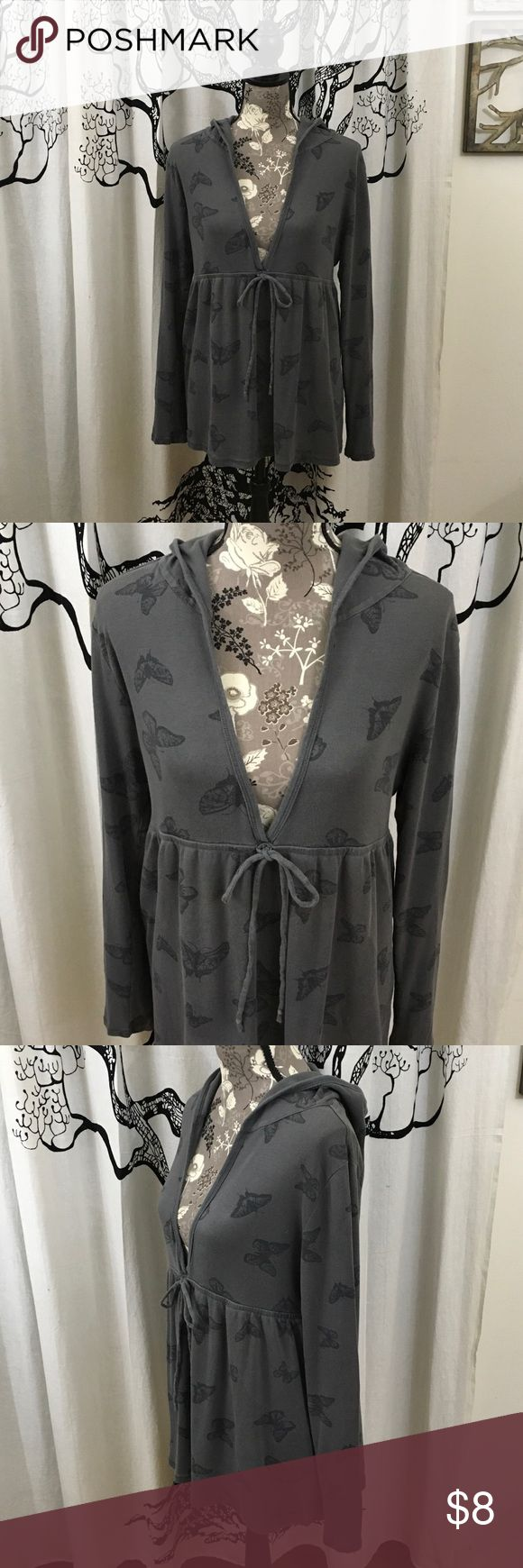 "Old Navy Soft Butterfly Babydoll Tunic Hoodie SZ L Super soft, super cute babydoll style tunic by Old Navy in dark grey with a butterfly print. Deep v-neck, tie front, long sleeves and hood. Super soft brushed 100% cotton. Gently loved, excellent condition with no imperfections. SZ L but may fit M/XL depending on how you like your fit. Please check measurements. 20"" bust, 19"" stretchy empire waist, 27.5"" length. Great for after yoga, weekends, or really any time you want a really…"