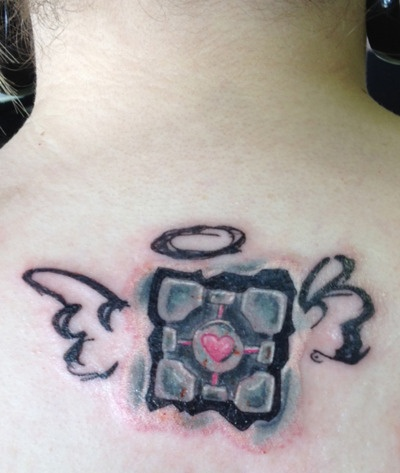 I promised myself after I'd lose 100 pounds that I'd get a tattoo that represents my geekiness. I officially lost my 125 pound in Feburary and decided to get my companion cube on leap day. It was done by Shannon at Scratch the Surface Tattoos in Orlando, FL. I think he did an amazing job and I am very happy with it!