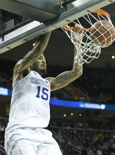 Kentucky's Willie Cauley-Stein dunked in the second half of Sweet 16 game against WV. 3-26-15