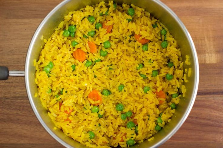 Yellow Rice has always been my go to side dish when in a pinch. This time I decided to throw some peas and carrots into the mix.