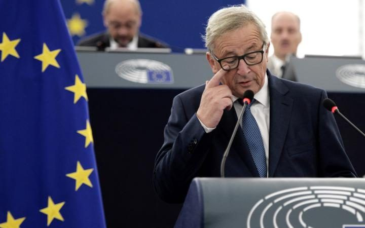 European Commission's President Jean-Claude Juncker delivers a speech as he…