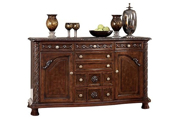 "The North Shore Server from Ashley Furniture HomeStore (AFHS.com). A deep rich stained finish and exquisite details come together to create the ultimate in grand traditional design with the elegance of the ""North Shore"" dining room collection."
