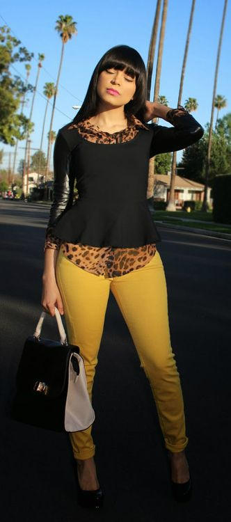 Cheetah print is so feminine and sexy.  The yellow jeans just set it off.