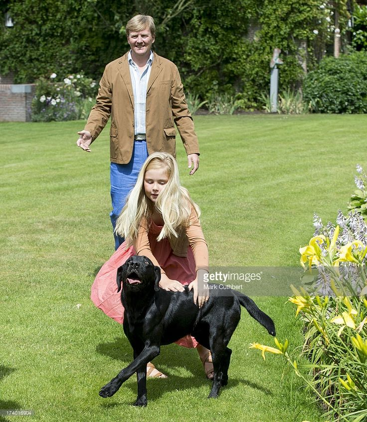 King Willem-Alexander of the Netherlands with Crown Princess Catharina-Amalia of the Netherlands and Skipper the dog at the annual Summer photocall at Horsten Estate on July 19, 2013 in Wassenaar, Netherlands.