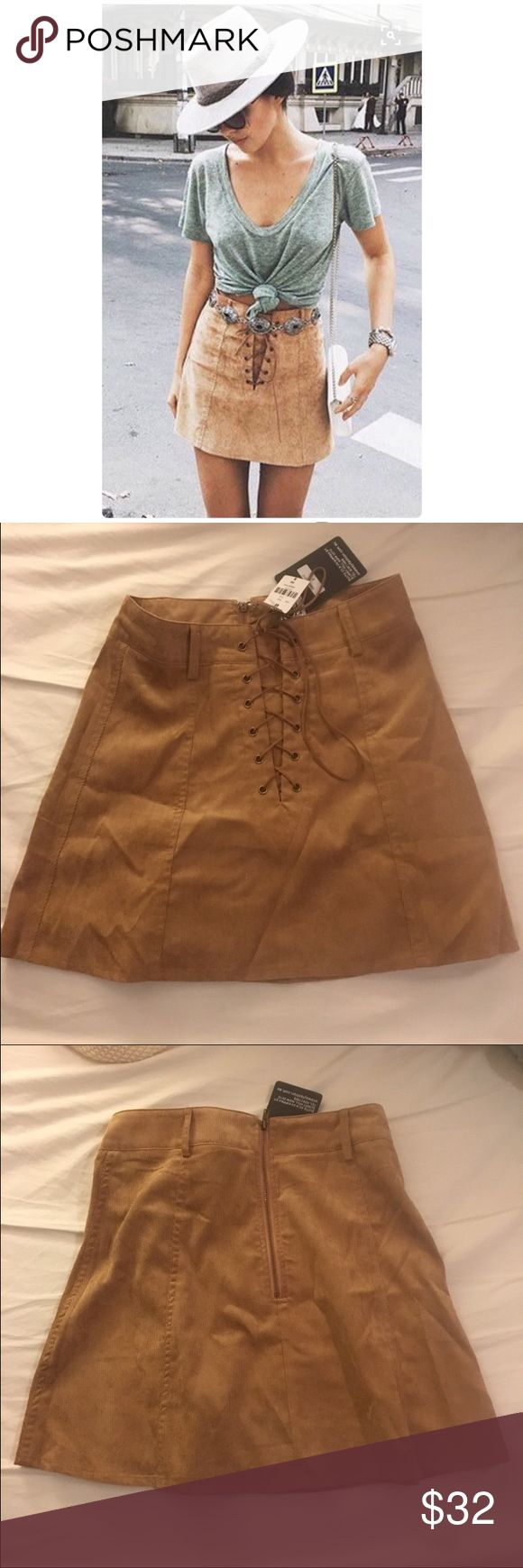 LF tan lace up skirt size small Amazing tan corduroy lace up skirt from LF in size small. Tag says size 8 which is Australian size 8 which is equivalent to a small. New with tags! LF Skirts Mini