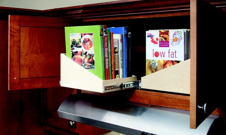 The recipe for great cookbook storage in your kitchen: Take 2 sloped Glide-Out shelves, turn sideways, install in cabinet of your choice and enjoy!