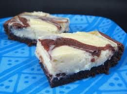 "Cheesecake Brownies.  This is my GO-TO receipe for a great and easy dessert.    In a mixing bowl, add:    1 package of German chocolate cake mix    1 egg, beaten    1/2 cup of melted butter    1 cup of chopped nuts    Mix this all together and press into a greased 13"" x 9"" baking pan and set aside.    In a"