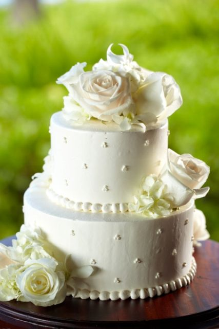 2 layer wedding cake with flowers two tier wedding cake with swiss dot detail and fresh 10113