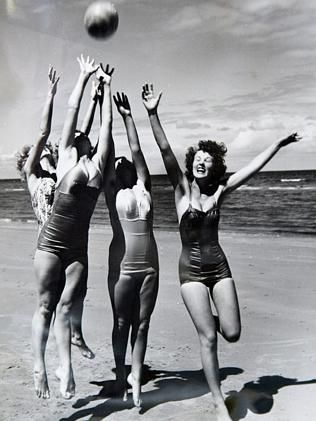Young women play with ball at Henley Beach in the 1950s. Picture: Department of Administr