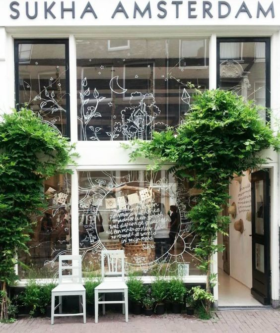 Hand drawn decoration and overgrown foliage transform your retail space into a wonderland.