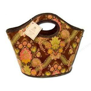 "Anna Griffin Carmen Brown Tropicana Bucket Tote by Anna Griffin. $33.49. Expandable snaps on the sides. Oil-cloth which makes it easy to clean. 16 1/8"" x 14 3/8"" x 10 1/8"". Anna Griffin's unique collections are designed expressly to add beauty and charm to contemporary living.  This is a perfect carry all tote with expandable snaps on the side to increase the capacity for larger items.  The oval base and built in handles makes this easy to carry.  The inside and surface can ..."