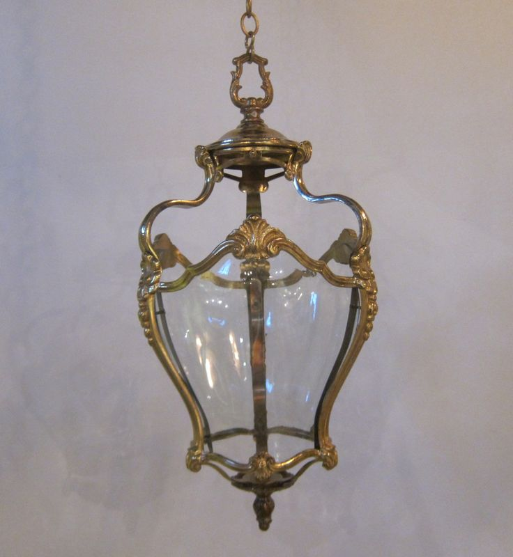 Pair of english three sided lanterns of good quality the lights retain their original curved