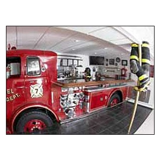 Man Cave...  Hose bed of fire truck = bar  Front of fire truck = entertainment center :)