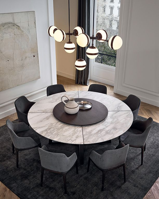 concorde table in spessart oak top in mat calacatta oro marble with central spinning tray in spessart oak grace armchairs in spessart oak and 5 grafite