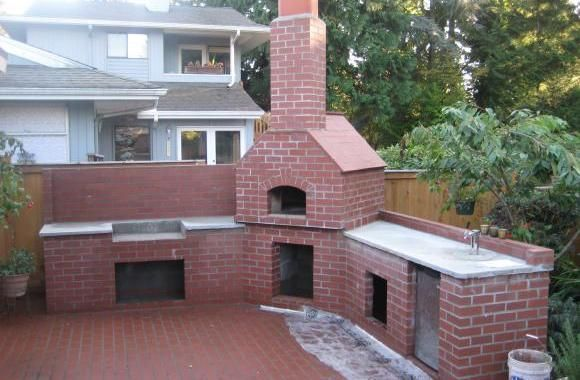 In addition to a very large brick patio this customer in Burien had us build a Brick BBQ complete with a wood fired Italian Pizza Oven!