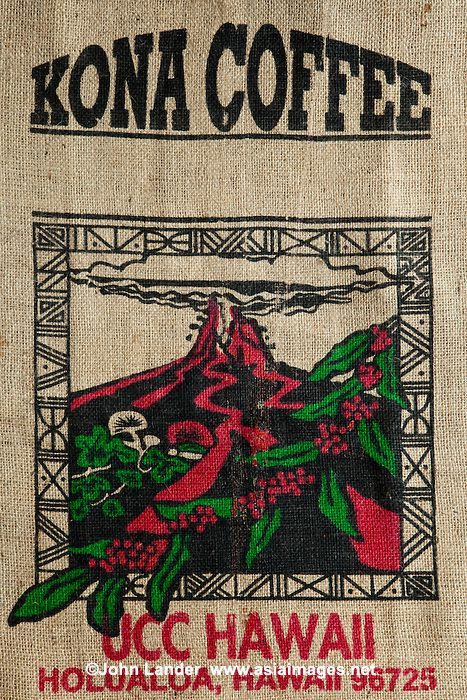 "Kona Coffee Burlap Bag - Kona coffee is the market name for coffee cultivated on the slopes of Hualalai and Mauna Loa in the North and South Kona Districts of the Big Island of Hawaii. It is one of the most expensive coffees in the world. Only coffee from the Kona Districts can be described as ""Kona"". The weather of sunny mornings, cloud or rain in the afternoon, little wind and mild nights combined with mineral-rich volcanic soil creates favorable coffee growing conditions. There are 800…"