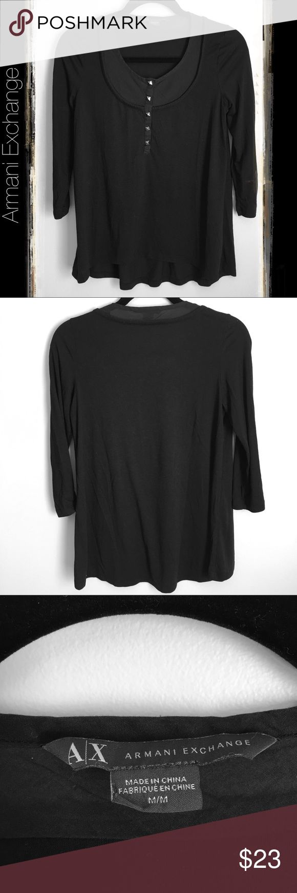 Armani Exchange 3/4 Sleeve Black Shirt Armani Exchange 3/4 sleeve black top with metal stud details. In great pre-loved condition. It's cut higher in the front and lower in the back. Perfect to pair with leggings or jeans. 100% cotton. The neck piece is 50% polyester 50% modal. A/X Armani Exchange Tops Blouses