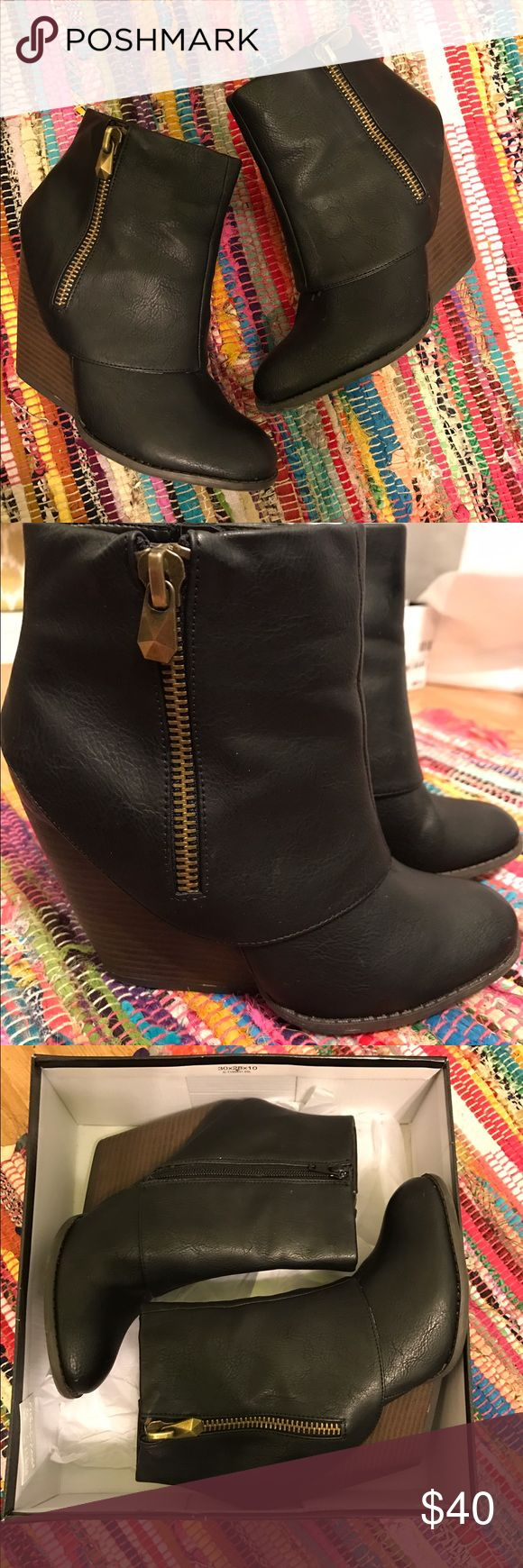 Wedge ankle boots Black wedged ankle boots with a wooden heel. Super cute and comfortable! Worn once Fergalicious Shoes Ankle Boots & Booties