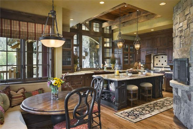 traditional kitchen with stone pizza oven and breakfast nook