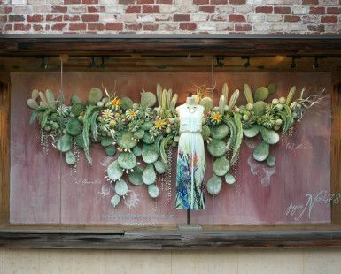 Anthropologie's autumn window displays are cacti in bloom