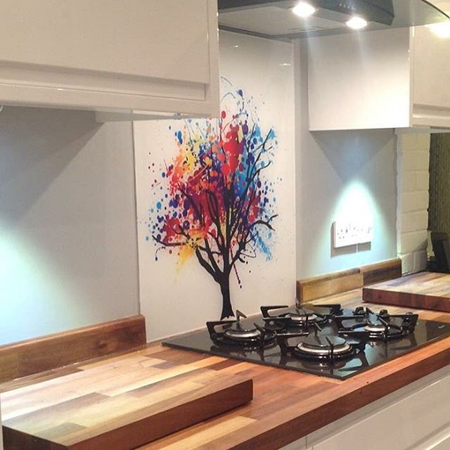 One of our best selling designs 'rainbow tree' fitted in a happy clients home. The perfect pop of colour and interest in an otherwise simple scheme. #rainbow #tree #colour #bestseller #diysplashbacks #art #pop