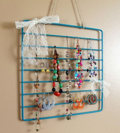 Use an old oven rack as a jewelry organizer -- or hang scarves or ties from it. #DIY #repurposed
