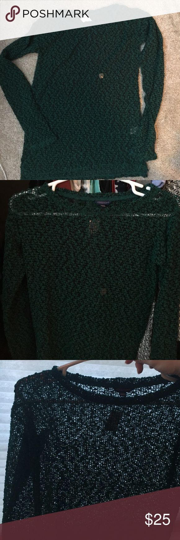 Emerald green and black open knit top Soft emerald and green top, open knit meaning you can see through it (not sheer material, just woven), really cute with a black lace cami under. Good for all seasons. Brand new never worn, size Xs. Aeropostale Tops