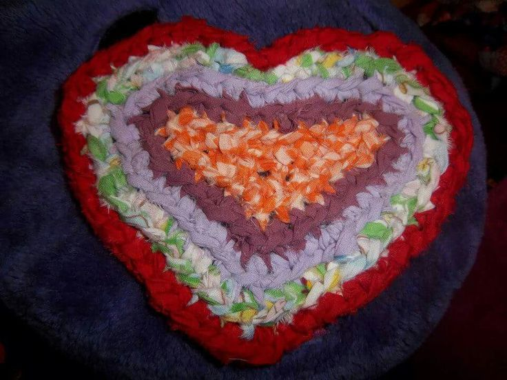 Heart shaped mini crocheted rag rug. To use as a hot pad or coaster.  Very versitile.. approximately 7 inches in diameter.  made with cotton sheets. Created by Amy Marie Hann